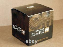 OLYMPUS OM ZUIKO 21mm F3.5 LENS NEW IN BOX LATER MC VERSION